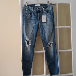 NWT. Kansan mid rise ripped knees skinny jeans